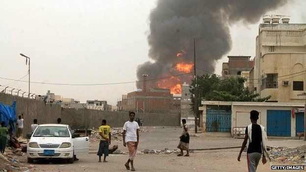 Smoke billows in the city of Aden