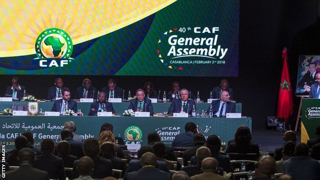Executive Committee members listen to a speech by Caf president Ahmad