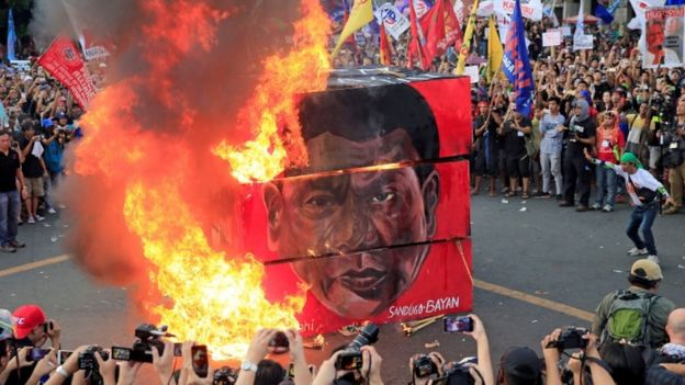 Effigy of Duterte is burned outside the presidential palace in Manila