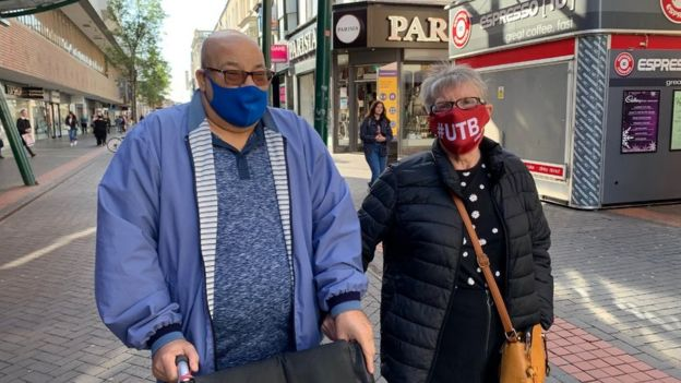Couple in Middlesbrough town centre wearing masks