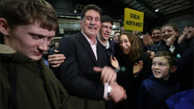 Green Party leader Eamon Ryan is surrounded by his family as he is elected in the Dublin Bay South constituency during the Irish General Election count at the RDS in Dublin.