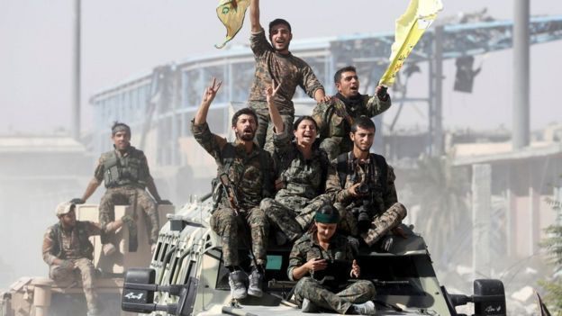 Syrian Democratic Forces fighters celebrate victory in Raqqa, Syria (17 October 2017)