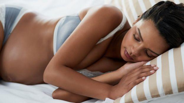 Pregnant woman sleeping.
