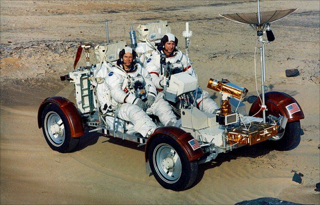 Duke and Young on Earth version of lunar rover