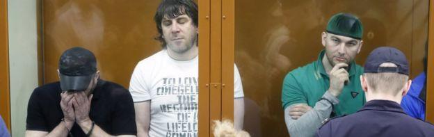 Khamzat Bakhayev (L), Temirlan Eskerkhanov (C) and Shadid Gubashev (R) hear their sentences in court