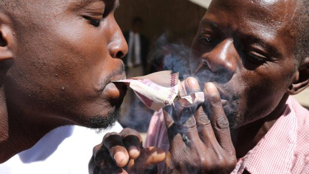 Protesters smoking Zimbabwe's old bond notes in Harare - - Wednesday 3 August 2016