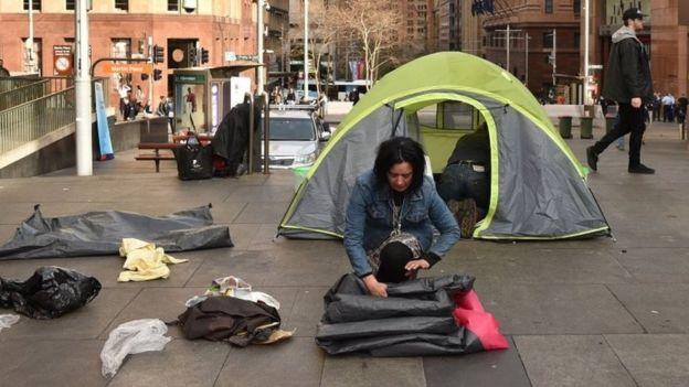 A woman packs up her belongings