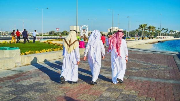 People walk along corniche in Doha (Feb 2018)