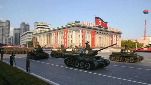 North Korean military vehicles pass through Kim Il-Sung square during a mass military parade in Pyongyang on October 10, 2015.