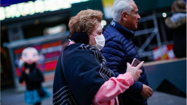 Woman wearing mask in Times Square, New York