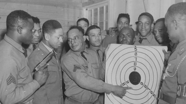 An instructor shows the results of the soldiers' target practice, Aberdeen, Maryland, April 8, 1941