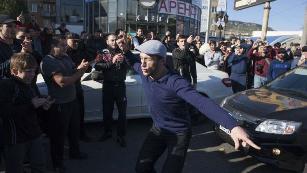 MMA supporters celebrate in the streets of Dagestan