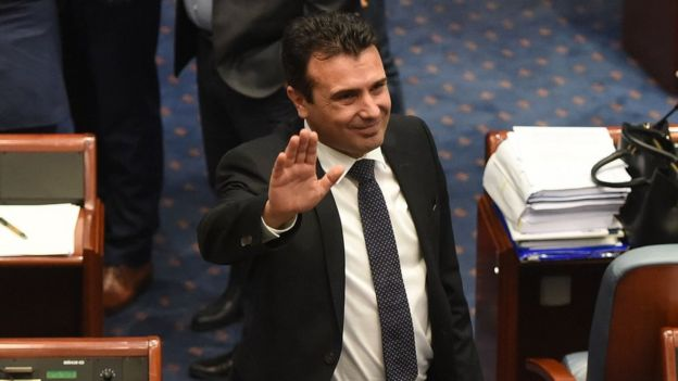 Macedonian Prime Minister Zoran Zaev Waves to journalists after Macedonian lawmakers voted to change the country's name