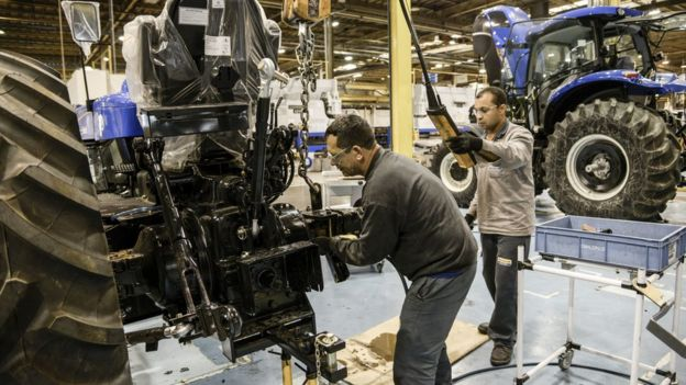 Workers assemble New Holland tractors in Curitiba