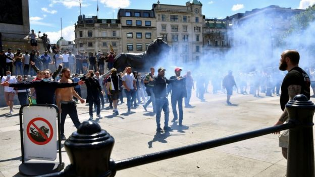 Flares and smoke bombs have been thrown in Trafalgar Square
