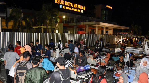 Patients are evacuated outside to the Mataram City hospital parking lot after a strong earthquake in Mataram, Lombok island