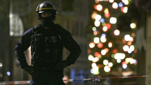 A police officer stands guard in the rue des Grandes Arcades in Strasbourg, eastern France, after a shooting, 11 December 2018