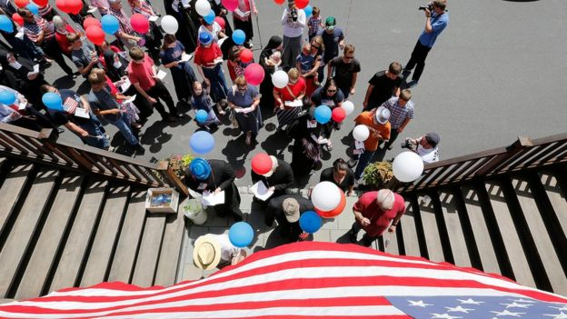 Participants march in a parade with red, white and blue balloons during a Fourth of July parade and celebration at the Motherhouse of the Daughters of Mary Convent in Round Top, New York, USA, 04 July 2017