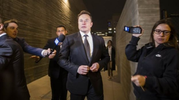 Elon Musk, chief executive officer of Tesla Inc, leaving court on Tuesday