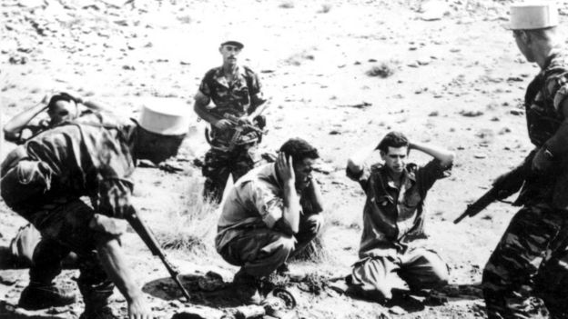 French solidiers round up indigenous Algerians during colonial war