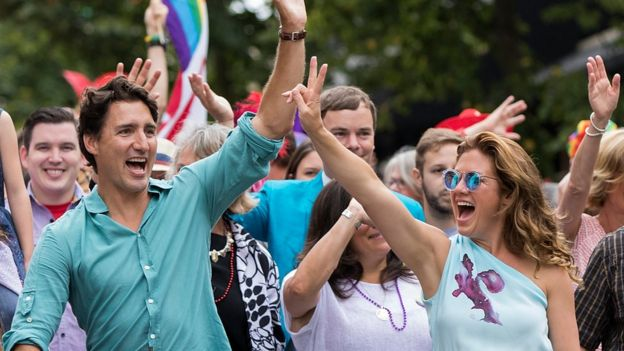 Prime Minister Justin Trudeau and his wife Sophie Gregoire Trudeau (R) at a Vancouver Pride parade