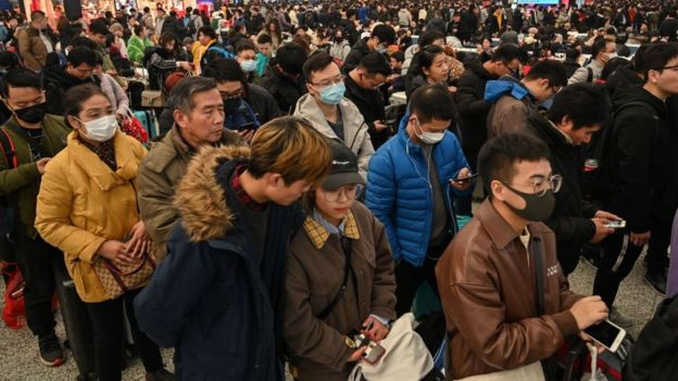 People wait to board trains at Hongqiao Railway Station in Shanghai on January 20, 2020