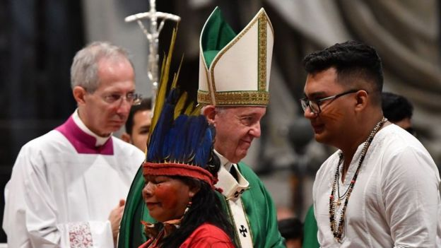 Representatives of the Amazon Rainforest's ethnic groups take part in a mass with Pope Francis on in 2019 at St. Peter's Basilica in the Vatican