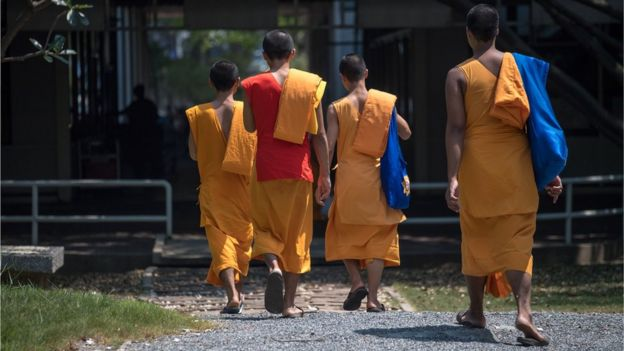 Buddhist monks enter the Wat Dhammakaya temple grounds, north of Bangkok, 1 March 2017