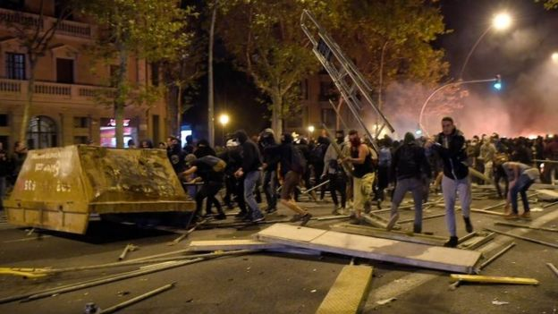 Protesters throw different objects at police in Barcelona. Photo: 16 October 2019