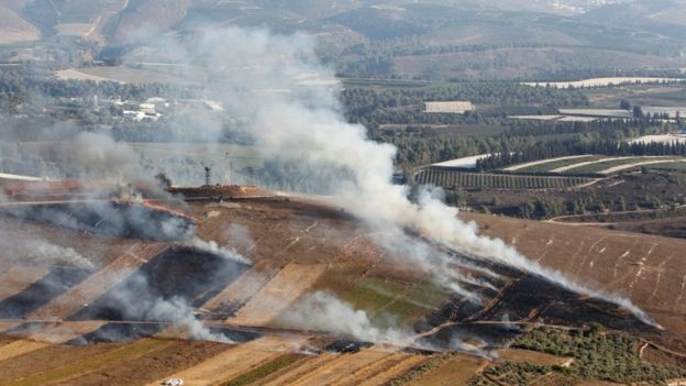 Smoke rises from shells fired from Israel in Maroun al-Ras village