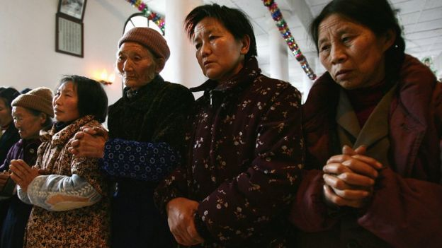 Women worship at a state-sanctioned Catholic church in Sichuan (file image)