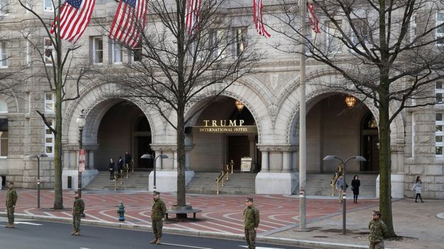 Members of the US military stand in front of the Trump International Hotel on Pennsylvania Avenue in Washington, DC.