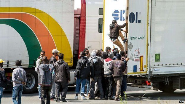 Immigrants getting into a lorry