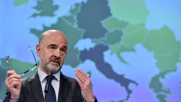 European Commissioner for Economic and Financial Affairs, Taxation and Customs Pierre Moscovici gestures as he speaks during a press conference at the European Commission headquarters in Brussels on May 7, 2019.