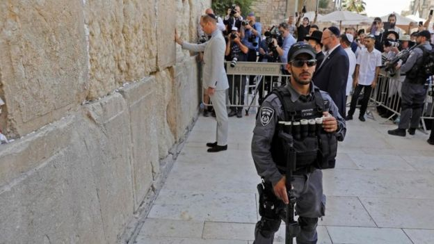 An Israeli policeman standing guard as the Duke of Cambridge visits the Western Wall
