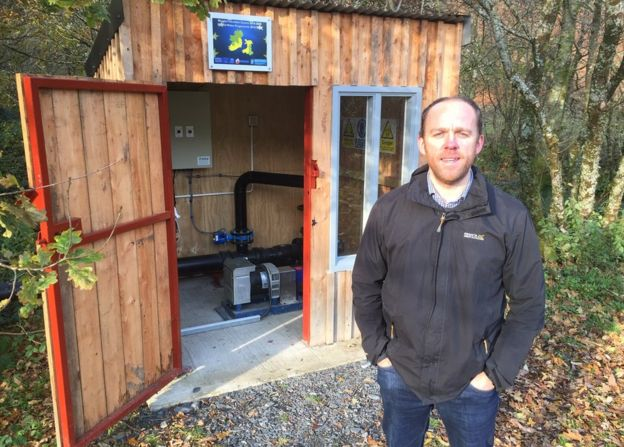 Dr Prysor Williams with the hydropower system in a shed