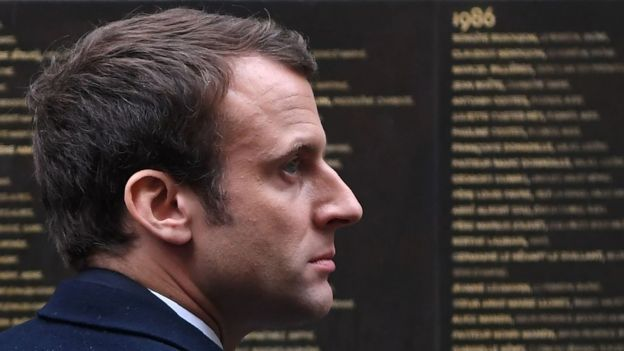 Emmanuel Macron stands by the Wall of the Righteous (Le Mur des Justes) during a visit to the Shoah Memorial on April 30, 2017 in Paris.