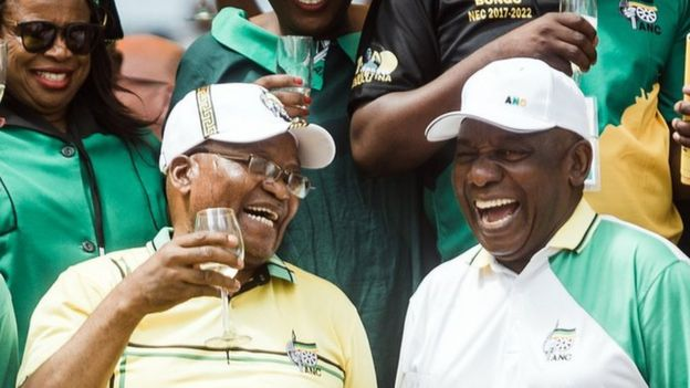 African National Congress (ANC) President Cyril Ramaphosa (R) toasts with former President Jacob Zuma (C)