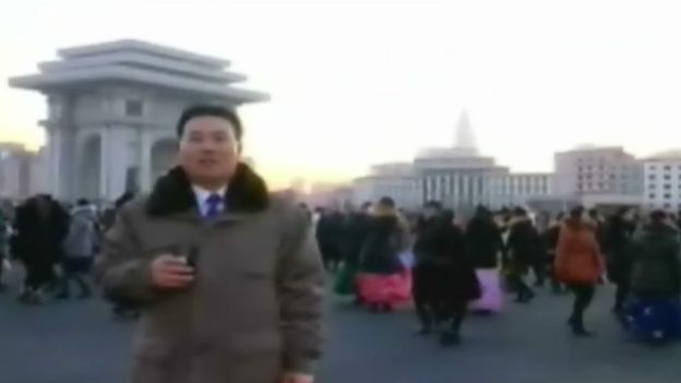 North Korean citizens dance in the streets in central Pyongyang