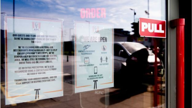 KFC window with sign on lockdown measures