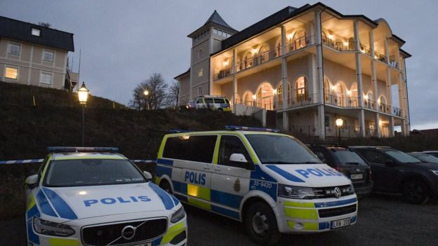 Police vehicles are seen near the premises of the Johannesbergs Castle in Rimbo, 50km north of Stockholm, Sweden, 4 December 2018