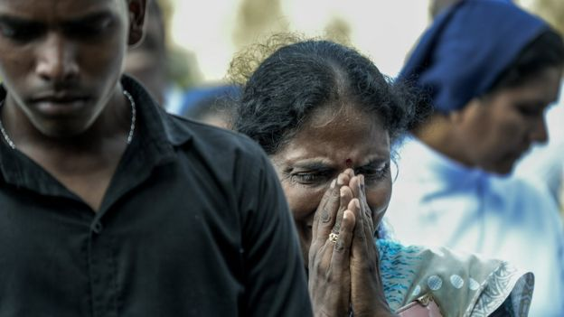Relatives cry at the graveside during the funeral of a victim of the Easter Sunday Bombings at a local cemetery on April 24, 2019 in Colombo,