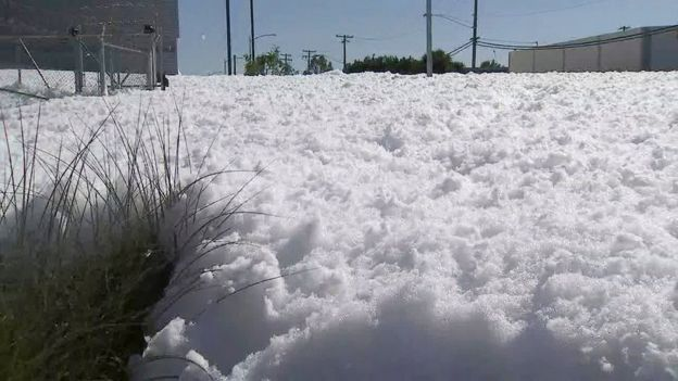 In this image provided courtesy of KTVU-TV, foam fills a street near Mineta San Jose International Airport Friday, Nov. 18, 2016, in San Jose, Calif.