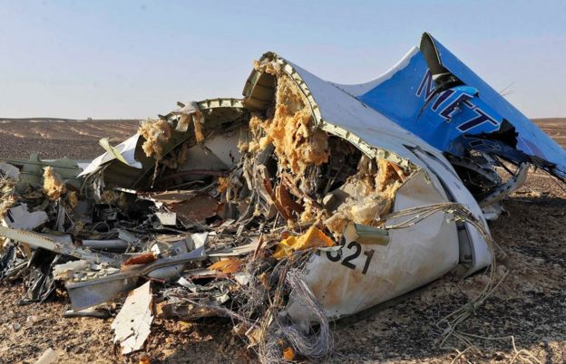 Debris from crashed Russian jet lies on the sand at the site of the crash, Sinai, Egypt, 31 October 2015.