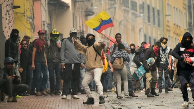 Protesters attend a demonstration against the ending of fuel subsidies in Ecuador