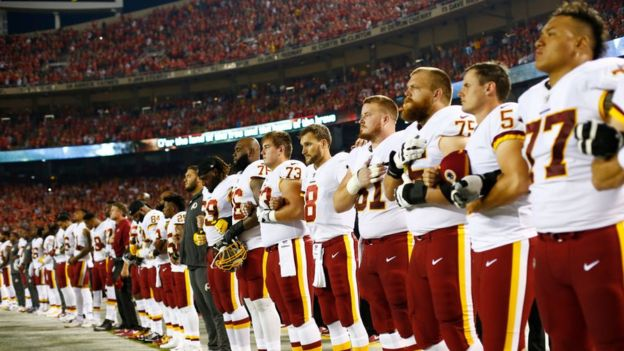 The Redskins team all stood for the national anthem in Kansas City