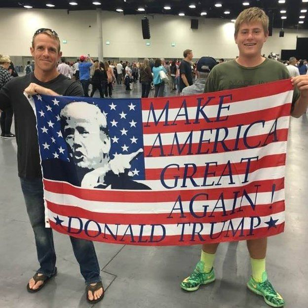 Eddie Gallagher holds a Make America Great Again flag
