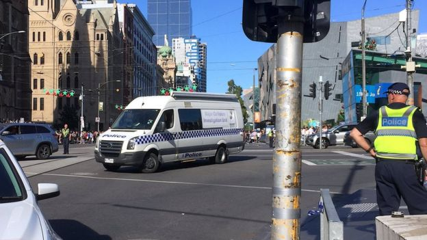 Police on Flinders Street after a car hit pedestrians, 21 December 2017