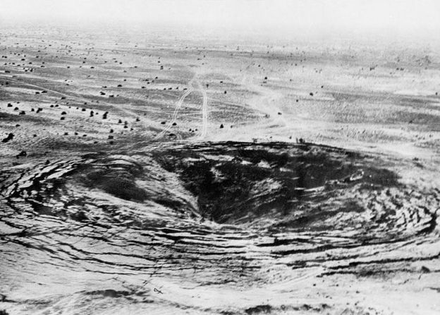 "A crater marks the site of the first Indian underground nuclear test conducted 18 May 1974 at Pokhran in the desert state of Rajasthan. After a gap of twenty-four years, India carried out another series of five underground nuclear explosions on 11 and 13 May 1998, provoking criticism from many countries around the world. A government statement said the 13 May tests ""completed the planned series"" which began in the desert range of Pokhran near the Pakistani border on 11 May 1998. (Photo credit should read PUNJAB PHOTO/AFP/Getty Images)"