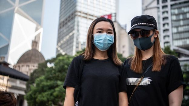 Two Hong Kong protesters wearing face masks, 5 October 2019